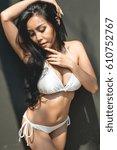sexy asian woman in white bikini | Shutterstock . vector #610752767