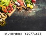 vegetables on wooden table | Shutterstock . vector #610771685