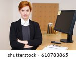 confident young receptionist... | Shutterstock . vector #610783865