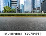 clean asphalt road with modern... | Shutterstock . vector #610784954