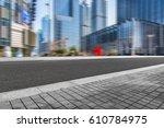 empty pavement and modern... | Shutterstock . vector #610784975
