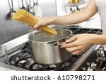 Woman In Kitchen Cooking...