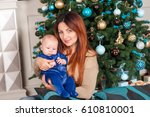 a small child in a blue suit   Shutterstock . vector #610810001
