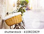 black vintage bicycle left on a ... | Shutterstock . vector #610822829
