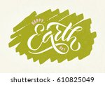 hand sketched text 'happy earth ... | Shutterstock .eps vector #610825049