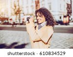 smiling white curly woman in... | Shutterstock . vector #610834529