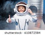 cute little girl in astronaut...   Shutterstock . vector #610872584