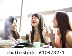 happy young women group  eating ... | Shutterstock . vector #610873271