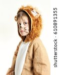 Small photo of Small boy in lion coat dress with whiskers looking to the left