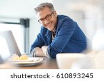 handsome 45 year old man at... | Shutterstock . vector #610893245