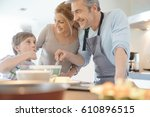 family cooking together in... | Shutterstock . vector #610896515