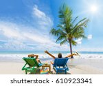 couple on the beach at tropical ... | Shutterstock . vector #610923341