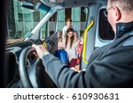 minivan taxi picking up two... | Shutterstock . vector #610930631