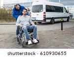 disabled man in a wheel chair... | Shutterstock . vector #610930655