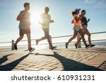 young people running along... | Shutterstock . vector #610931231