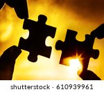 two hands trying to connect... | Shutterstock . vector #610939961