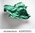 abstract piece of green fabric... | Shutterstock . vector #610953551