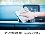 hand cleaning the car interior... | Shutterstock . vector #610964459