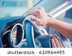 hand cleaning the car interior... | Shutterstock . vector #610964495