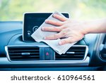hand cleaning the car interior... | Shutterstock . vector #610964561