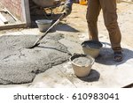 mix a cement at construction... | Shutterstock . vector #610983041