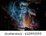 team workers are welding...   Shutterstock . vector #610993595
