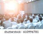 speakers on the stage with rear ... | Shutterstock . vector #610996781
