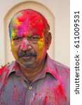 Small photo of Mathura,India - March 13,2017 : Painted face of people during Holi festival in Mathura,India.People smear each other with colours and drench each other during this religious and colorful festival.