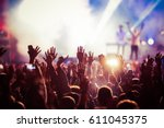 crowd at concert   summer music ... | Shutterstock . vector #611045375