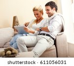 young couple sitting in they... | Shutterstock . vector #611056031
