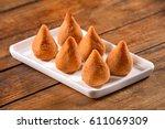 brazilian snack   coxinha | Shutterstock . vector #611069309