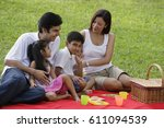 a family have a picnic together ... | Shutterstock . vector #611094539