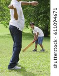 a father and son play cricket... | Shutterstock . vector #611094671