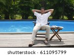 man relaxing in chair by the... | Shutterstock . vector #611095799