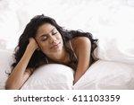 indian woman relaxing in bed   Shutterstock . vector #611103359