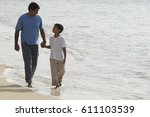 father and son holding hands... | Shutterstock . vector #611103539