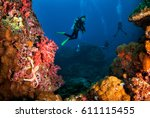 young woman scuba diving on... | Shutterstock . vector #611115455