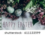 happy easter text sign on ...   Shutterstock . vector #611133599
