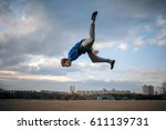 teenager parkour jumping | Shutterstock . vector #611139731