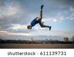 teenager parkour jumping | Shutterstock . vector #611139731