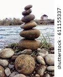 rock balancing at the riverside  | Shutterstock . vector #611155337