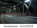 asphalt road under the steel... | Shutterstock . vector #611155529