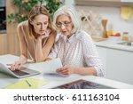 friendly girl explaining some... | Shutterstock . vector #611163104