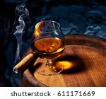 cognac and cigar on old oak... | Shutterstock . vector #611171669