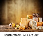 various kind of cheese served... | Shutterstock . vector #611175209