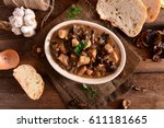 stew with meat  mushrooms and... | Shutterstock . vector #611181665