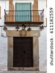 Small photo of Ancient door with feudal coat of arms on the lintel. Old town of Orgaz. Spain.