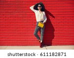 beautiful young woman walking... | Shutterstock . vector #611182871