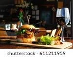 gourmet burger salad wine | Shutterstock . vector #611211959
