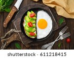 fried egg in pan and vegan... | Shutterstock . vector #611218415